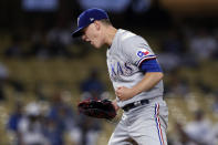 Texas Rangers starting pitcher Kolby Allard reacts after striking out Los Angeles Dodgers' Chris Taylor during the fifth inning of a baseball game in Los Angeles, Saturday, June 12, 2021. (AP Photo/Alex Gallardo)