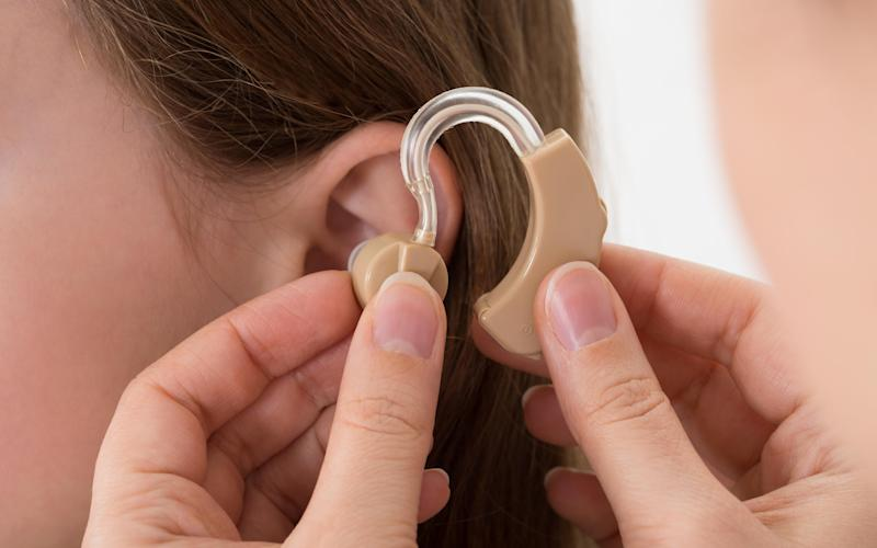 A hearing aid may stop older people becoming socially isolated, scientists believe - © Panther Media GmbH / Alamy Stock Photo