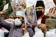 Muslim activists from various organizations hold placards and participate in a protest against France, near the French Consulate, in Kolkata, India, Saturday, Oct. 31, 2020. Muslims have been calling for both protests and a boycott of French goods in response to France's stance on caricatures of Islam's most revered prophet. (AP Photo/Bikas Das)