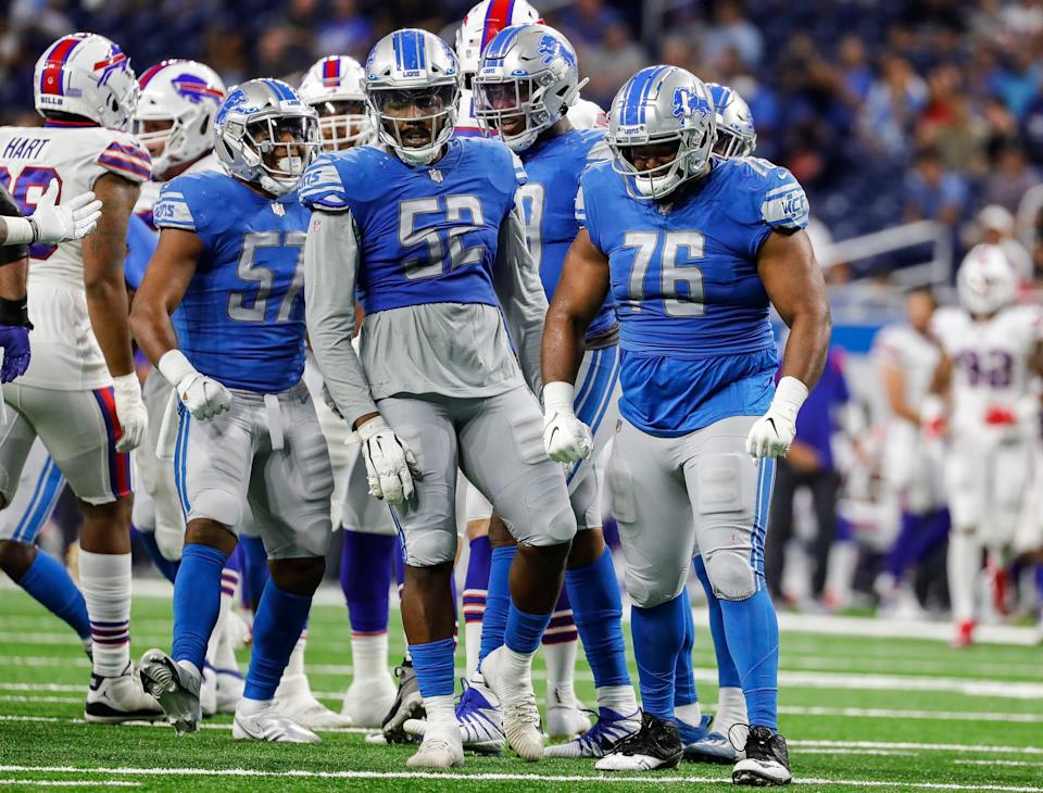 Detroit Lions defensive end Bruce Hector (76) celebrates a tackle against the Buffalo Bills during the second half of the preseason game at Ford Field in Detroit on Friday, Aug. 13, 2021.