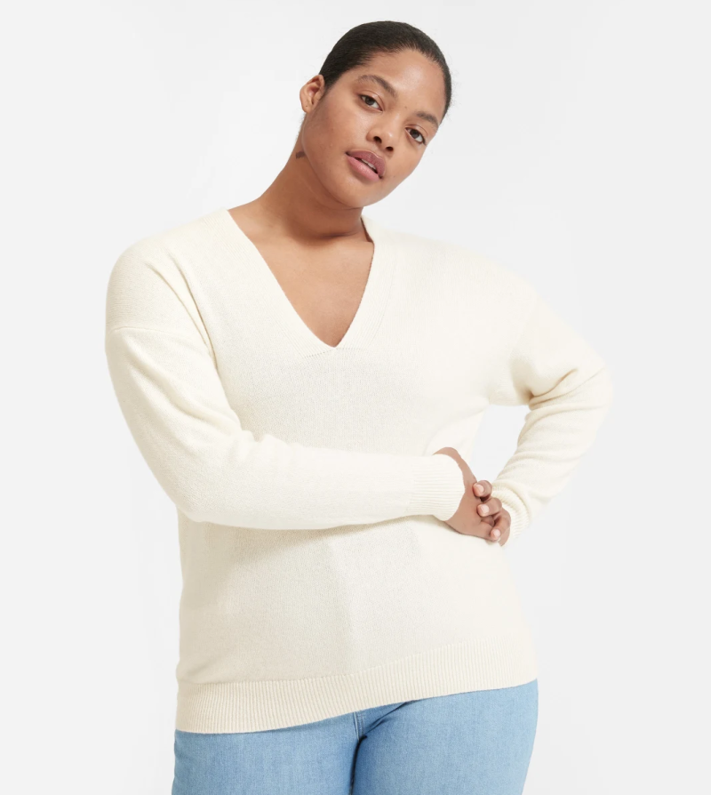 This sweater's deep, elongating neckline and generous length create a flattering fit. (Photo: Everlane)