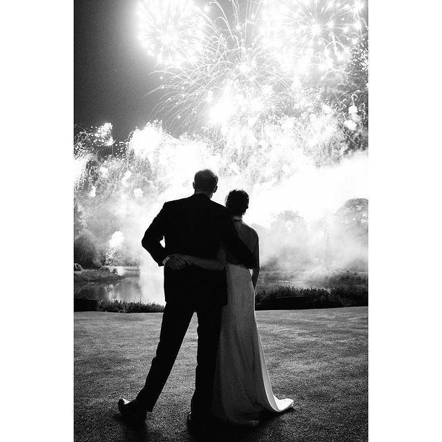 """<p>The newlyweds shared a black-and-white photograph on Instagram, taken by Chris Allerton, to celebrate the festive period. In the snap, the couple look on at a firework display at Frogmore House following their wedding in May 2018, with the Duchess of Sussex dressed in a halterneck Stella McCartney gown. </p><p><a href=""""https://www.instagram.com/p/BrXYWCsl0jR/?utm_source=ig_web_copy_link"""" rel=""""nofollow noopener"""" target=""""_blank"""" data-ylk=""""slk:See the original post on Instagram"""" class=""""link rapid-noclick-resp"""">See the original post on Instagram</a></p>"""