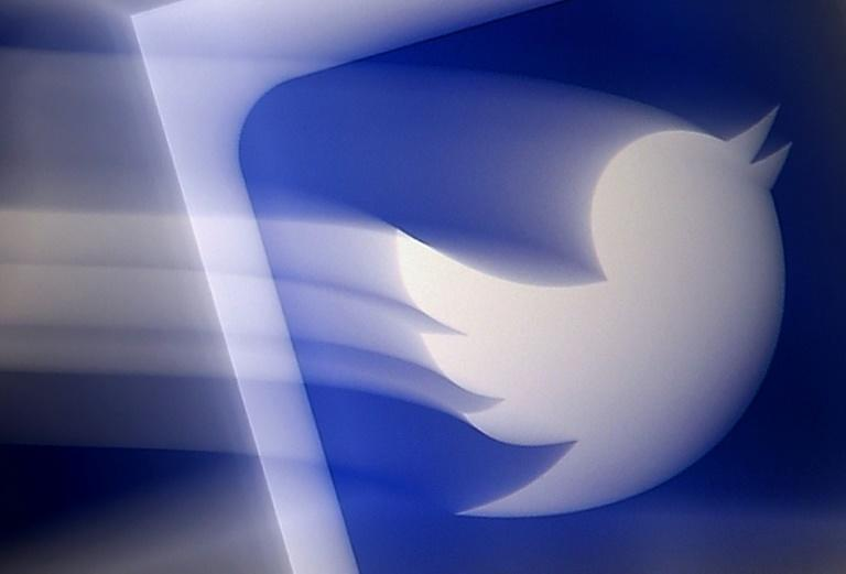 (FILES) In this file photo illustration, a Twitter logo is displayed on a mobile phone on August 10, 2020, in Arlington, Virginia.