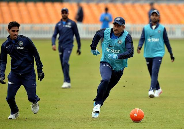 India cricket captain MS Dhoni plays football during a warm up sesion before play on the third day of the cricket match against Leicestershire at Grace Road in Leicester, England on June 28, 2014 (AFP Photo/Paul Ellis)