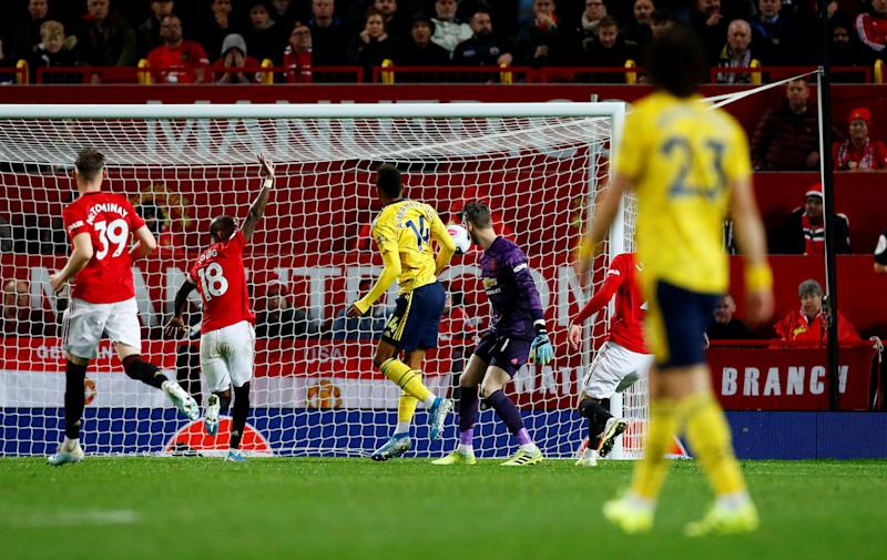 "Soccer Football - Premier League - Manchester United v Arsenal - Old Trafford, Manchester, Britain - September 30, 2019 Arsenal's Pierre-Emerick Aubameyang scores their first goal Action Images via Reuters/Jason Cairnduff EDITORIAL USE ONLY. No use with unauthorized audio, video, data, fixture lists, club/league logos or ""live"" services. Online in-match use limited to 75 images, no video emulation. No use in betting, games or single club/league/player publications. Please contact your account representative for further details."