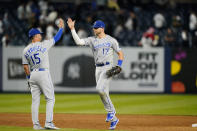 Kansas City Royals second baseman Whit Merrifield (15) and left fielder Hunter Dozier (17) celebrate after the Royals defeated the New York Yankees 6-5 in a baseball game, Tuesday, June 22, 2021, at Yankee Stadium in New York. (AP Photo/Kathy Willens)