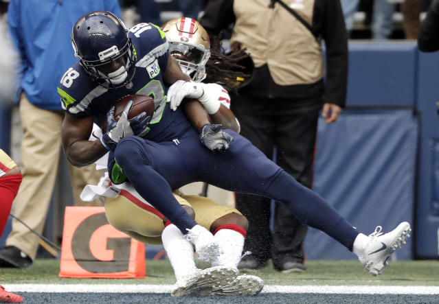 Seattle Seahawks wide receiver Jaron Brown (18) catches a pass for a touchdown during the first half of an NFL football game against the San Francisco 49ers, Sunday, Dec. 2, 2018, in Seattle. (AP Photo/Elaine Thompson)