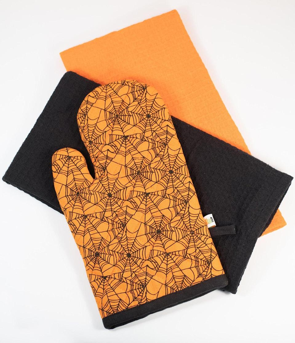 <p>Cooking just got a whole lot more spooky with the <span>Orange Spiderweb Oven Mitt and Dish Towel Set</span> ($28). </p>