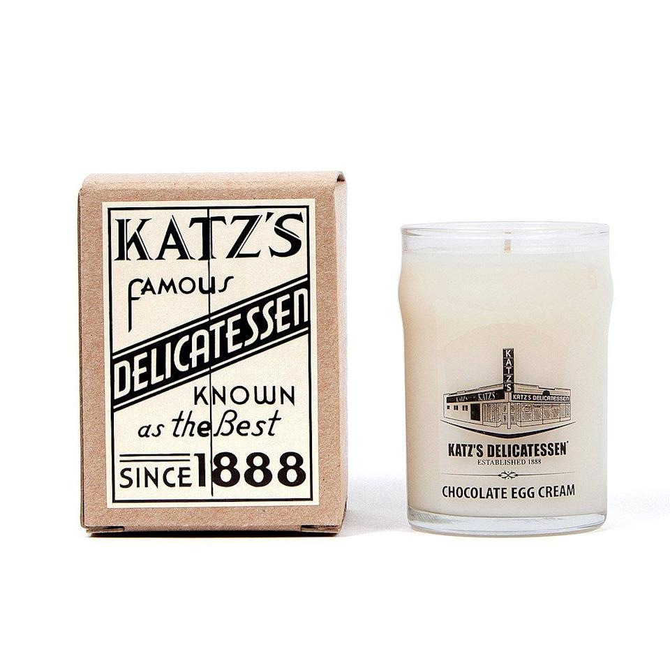 "<p><strong>UncommonGoods</strong></p><p>uncommongoods.com</p><p><strong>$28.00</strong></p><p><a href=""https://www.uncommongoods.com/product/katzs-chocolate-egg-cream-candle"" rel=""nofollow noopener"" target=""_blank"" data-ylk=""slk:BUY NOW"" class=""link rapid-noclick-resp"">BUY NOW</a></p><p>Nothing says classic holiday season in NYC like the scent of this iconic beverage. </p>"