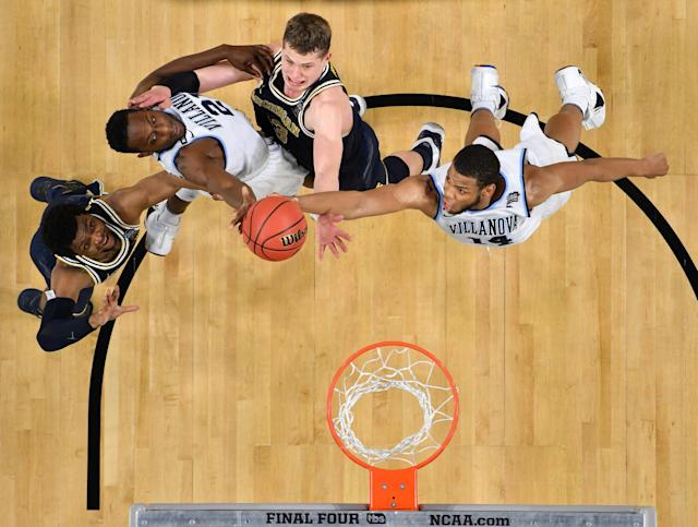 Apr 2, 2018; San Antonio, TX, USA; Villanova Wildcats forward Omari Spellman (14) and Dhamir Cosby-Roundtree (21) battle for a loose ball with Michigan Wolverines forward Moritz Wagner (13) and Zavier Simpson (3) during the second half in the championship game of the 2018 men's Final Four at Alamodome. Mandatory Credit: Robert Deutsch-USA TODAY Sports TPX IMAGES OF THE DAY