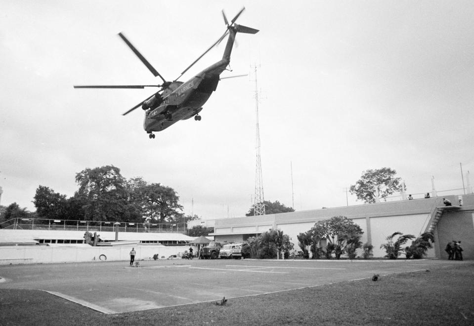 FILE - In this April 29, 1975, file photo the helicopter zone at the U.S. Embassy in Saigon, Vietnam, showing last minute evacuation of authorized personnel and civilians. With U.S. and NATO forces under a Sept. 11, 2021, deadline to leave Afghanistan, many are recalling that desperate, hasty exodus as they urge the Biden administration to evacuate thousands of Afghans who worked as interpreters or otherwise helped U.S. military operations there in the past two decades. (AP Photo, File)
