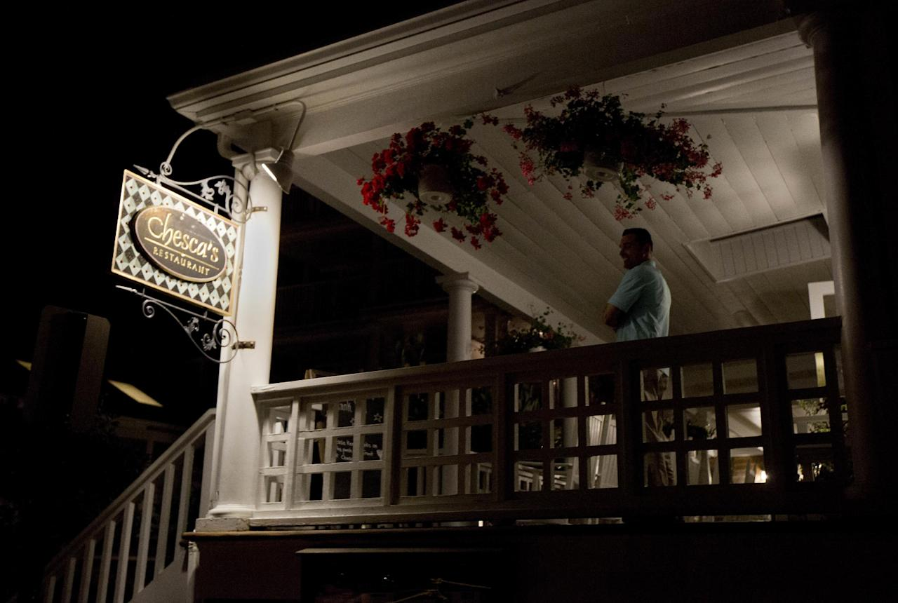 A Secret Service agent stands outside at the balcony of Chesca's Restaurant in downtown Edgartown, Mass., on Martha's Vineyard, Saturday, Aug. 20, 2016, where President Barack Obama and the first lady Michelle Obama are dining. (AP Photo/Manuel Balce Ceneta)