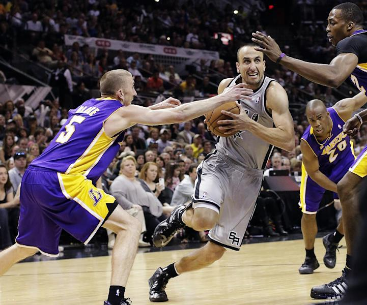 San Antonio Spurs' Manu Ginobili, center, of Argentina, drives between Los Angeles Lakers' Steve Blake, left, and Dwight Howard during the second half of Game 1 of their first-round NBA basketball playoff series, Sunday, April 21, 2013, in San Antonio. San Antonio won 91-79. (AP Photo/Eric Gay)
