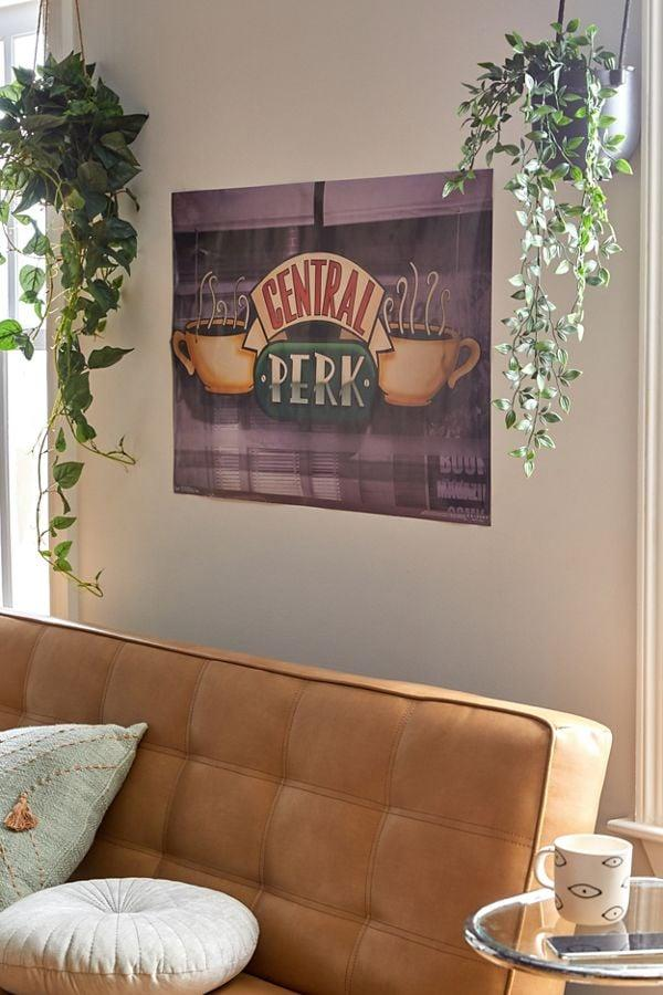 """<p>Transform your home into the iconic cafe with this <a href=""""https://www.popsugar.com/buy/Central-Perk-Poster-438997?p_name=Central%20Perk%20Poster&retailer=urbanoutfitters.com&pid=438997&price=10&evar1=buzz%3Aus&evar9=44164386&evar98=https%3A%2F%2Fwww.popsugar.com%2Fentertainment%2Fphoto-gallery%2F44164386%2Fimage%2F46069643%2FCentral-Perk-Poster&list1=tv%2Cfriends%2Cgift%20guide%2Cnostalgia%2Centertainment%20gifts&prop13=api&pdata=1"""" rel=""""nofollow"""" data-shoppable-link=""""1"""" target=""""_blank"""" class=""""ga-track"""" data-ga-category=""""Related"""" data-ga-label=""""https://www.urbanoutfitters.com/shop/friends-central-perk-poster?category=SEARCHRESULTS&amp;color=050"""" data-ga-action=""""In-Line Links"""">Central Perk Poster</a> ($10).</p>"""
