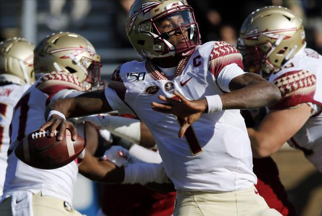 Florida State quarterback James Blackman drops back to throw a touchdown pass to wide receiver Tamorrion Terry in the first half of an NCAA college football game against Boston College, Saturday, Nov. 9, 2019, in Boston. (AP Photo/Bill Sikes)