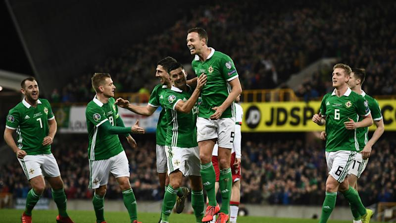 Northern Ireland moved top of Group C with a 2-1 victory over Belarus in Euro 2020 qualifying, Josh Magennis' late goal the difference.