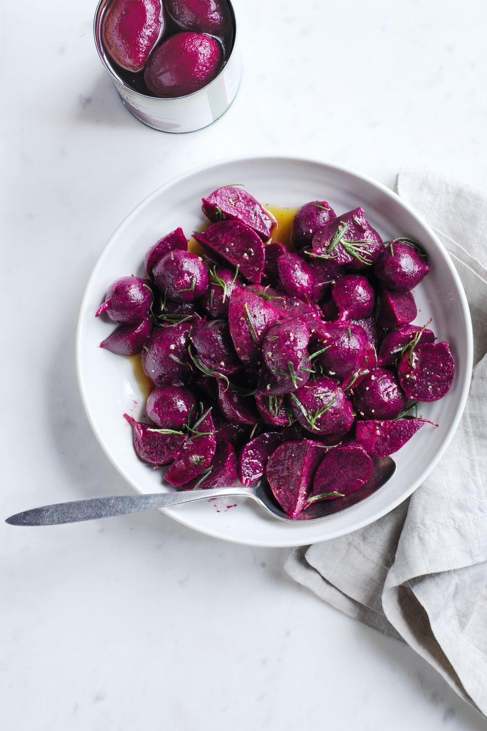 """<p>Beets are a low-cost way to be mindful of a budget pinch without sacrificing great flavor — this dish is only 67 cents per serving! After whisking together the ingredients and pouring over the beets, they can be refrigerated for up to two days. </p><p><a href=""""https://www.womansday.com/food-recipes/food-drinks/recipes/a52069/marinated-beets-with-rosemary/"""" rel=""""nofollow noopener"""" target=""""_blank"""" data-ylk=""""slk:Get the Marinated Beets with Rosemary recipe."""" class=""""link rapid-noclick-resp""""><em><strong>Get the Marinated Beets with Rosemary recipe.</strong></em></a> </p>"""