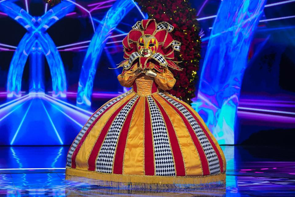 This image and the information contained herein is strictly embargoed until 00.01 Friday 15th January 2021  From Bandicoot TV  The Masked Singer: SR2: Ep4 on ITV  Pictured: Harlequin.  This photograph is (C) Bandicoot TV and can only be reproduced for editorial purposes directly in connection with the programme or event mentioned above, or ITV plc. Once made available by ITV plc Picture Desk, this photograph can be reproduced once only up until the transmission [TX] date and no reproduction fee will be charged. Any subsequent usage may incur a fee. This photograph must not be manipulated [excluding basic cropping] in a manner which alters the visual appearance of the person photographed deemed detrimental or inappropriate by ITV plc Picture Desk.  This photograph must not be syndicated to any other company, publication or website, or permanently archived, without the express written permission of ITV Picture Desk. Full Terms and conditions are available on the website www.itv.com/presscentre/itvpictures/terms  For further information please contact: james.hilder@itv.com / 0207 157 3052
