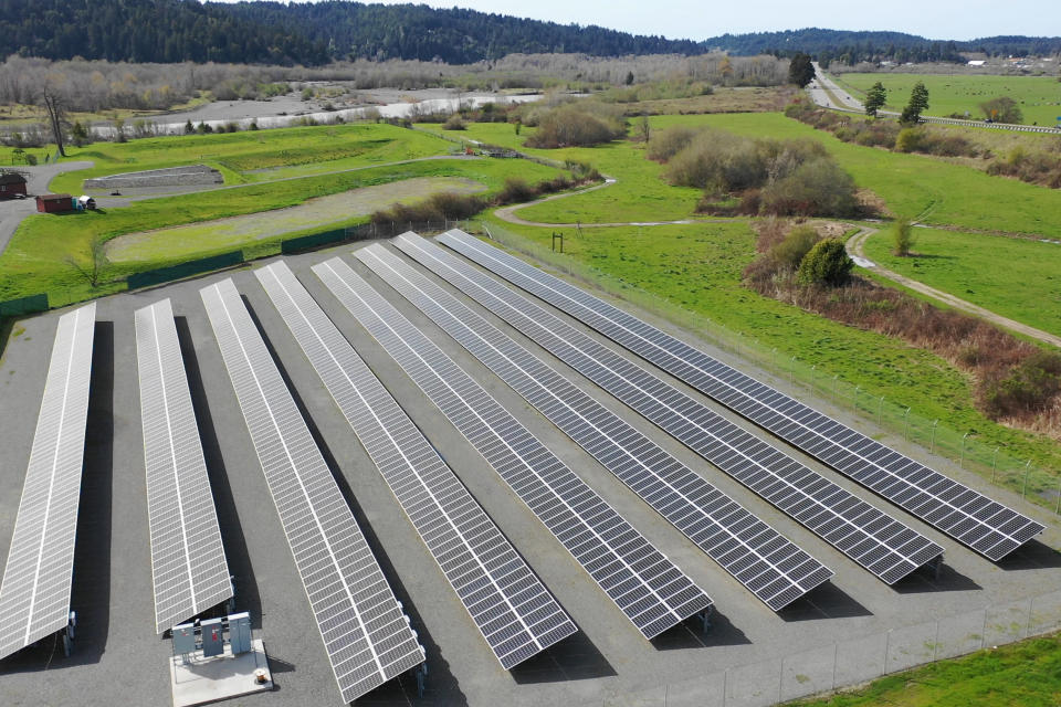 This aerial photo provided by the Blue Lake Rancheria shows a solar array that is paired with a microgrid in Blue Lake, Calif., in 2017. A Native American reservation on California's far northern coast kept the electricity flowing with the help of two microgrids that can disconnect from the larger electrical grid and switch to using solar energy generated and stored in battery banks near its hotel-casino. As most of rural Humboldt County sat in the dark during a planned shutoff in October 2019, the Blue Lake Rancheria became a lifeline for thousands of its neighbors. (Blue Lake Rancheria via AP)