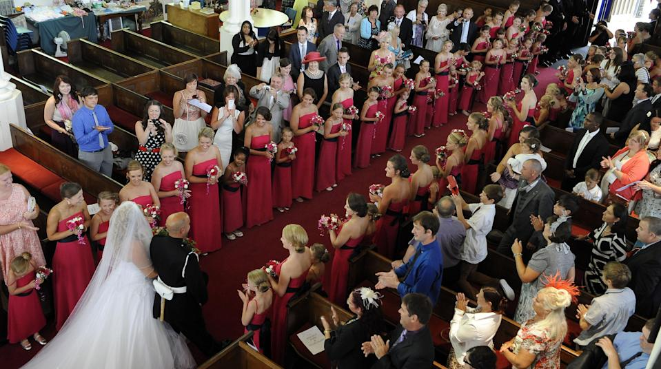 "<div class=""caption-credit""> Photo by: Rex USA</div><p> The bridesmaids lined the length of the aisle as the bride and groom exited the church. </p>"
