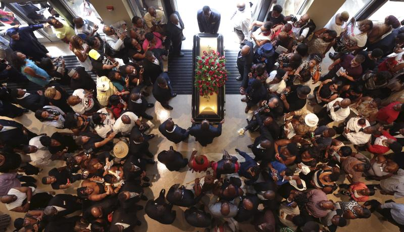 The casket of Michael Brown exits Friendly Temple Missionary Baptist Church at the end of his funeral in St. Louis