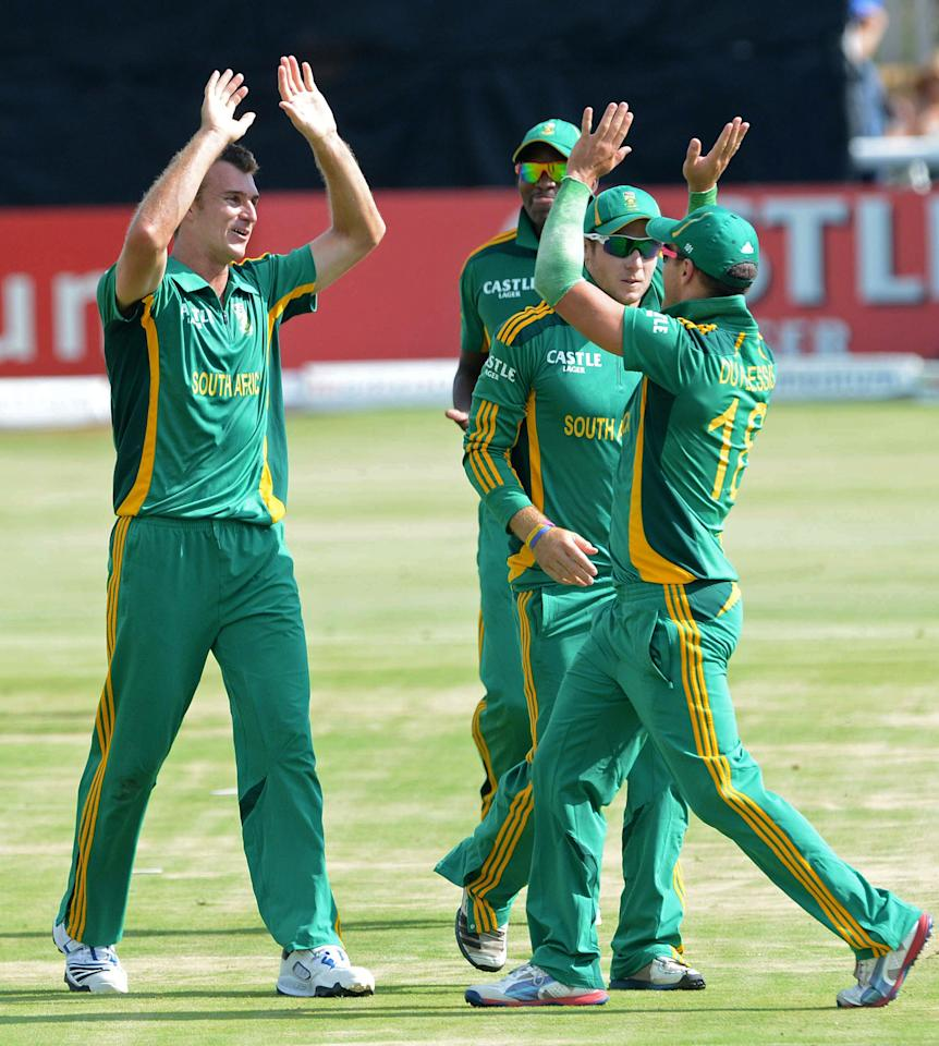 POTCHEFSTROOM, SOUTH AFRICA - JANUARY 25:  Ryan McLaren of South Africa celebrates the wicket of Brendon McCullum of New Zealand with team-mates during the 3rd One Day International match between South Africa and New Zealand at Senwes Park on January 25, 2013 in Potchefstroom, South Africa.  (Photo by Lee Warren/Gallo Images/Getty Images)