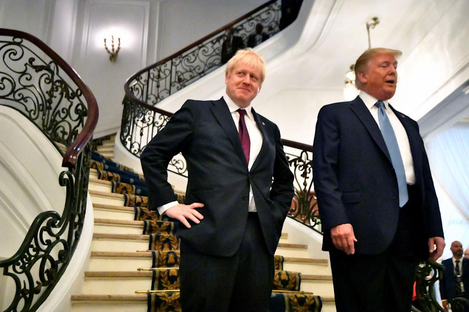 BIARRITZ, FRANCE - AUGUST 25: U.S. President Donald Trump and Britain's Prime Minister Boris Johnson arrive for a bilateral meeting during the G7 summit on August 25, 2019 in Biarritz, France. The French southwestern seaside resort of Biarritz is hosting the 45th G7 summit from August 24 to 26. High on the agenda will be the climate emergency, the US-China trade war, Britain's departure from the EU, and emergency talks on the Amazon wildfire crisis. (Photo by Dylan Martinez - Pool/Getty Images)