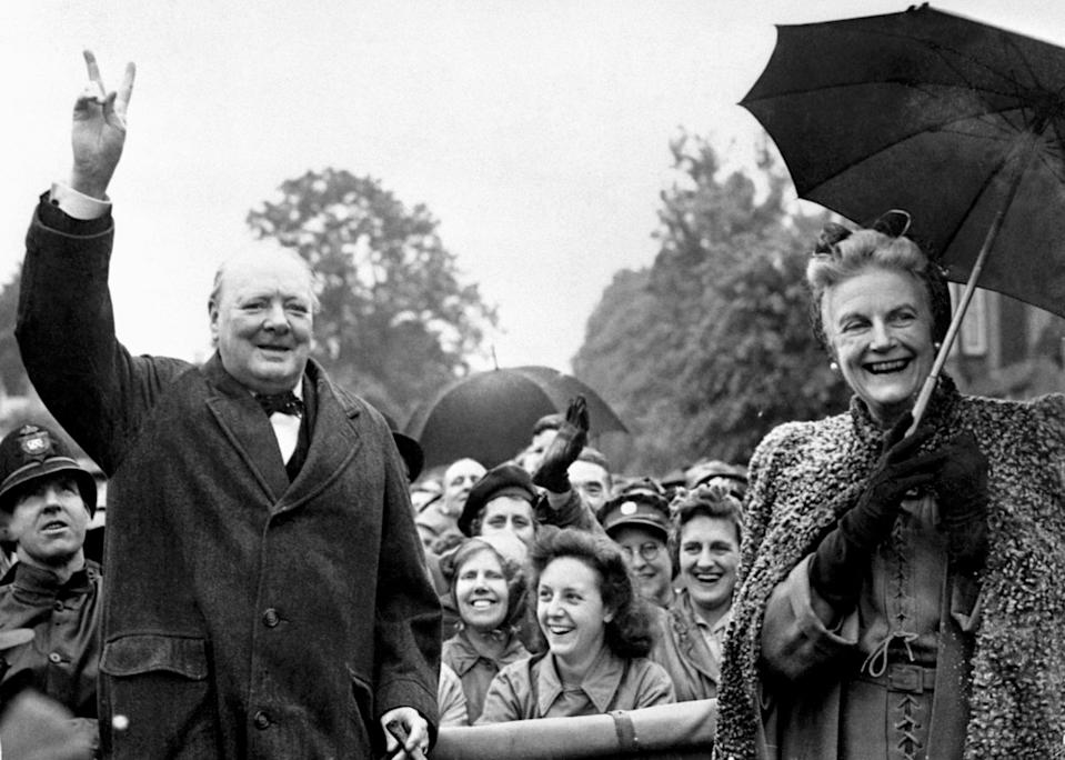"""Sir Winston Churchill with his wife Clementine at Loughton. in June 1945, having declared, """"Never was so much owed by so many to so few"""". (PA)"""