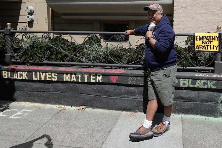 James Juanillo chalked 'Black Lives Matter' on his own wall – and was accused of illegal action by someone who assumed he didn't live there: AP