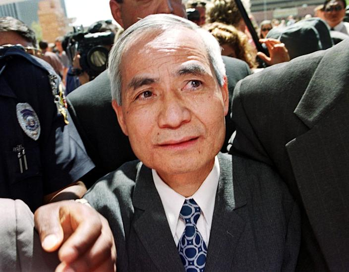 Former Los Alamos nuclear scientist Wen Ho Lee (C) is escorted back into the Federal Courthouse after addresses the media following his release from nine months of solitary confinement, Sept. 13, 2000, in Albuquerque, New Mexico.  (Photo: Mike Fiala/AFP/Getty Images)