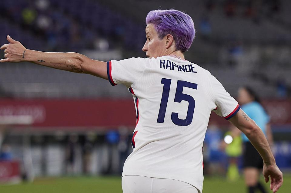 <p>On the back of Rapinoe's right arm are three interconnected triangles. She's never disclosed the design's exact meaning.</p>