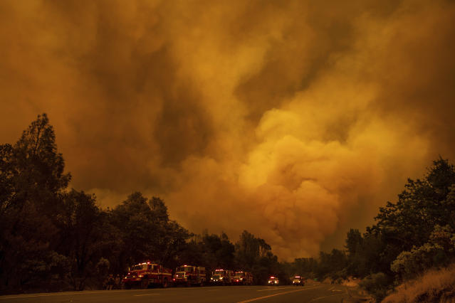 <p>The Carr Fire burns along Highway 299 in Shasta, Calif., on July 26, 2018. (Photo: Noah Berger/AP) </p>