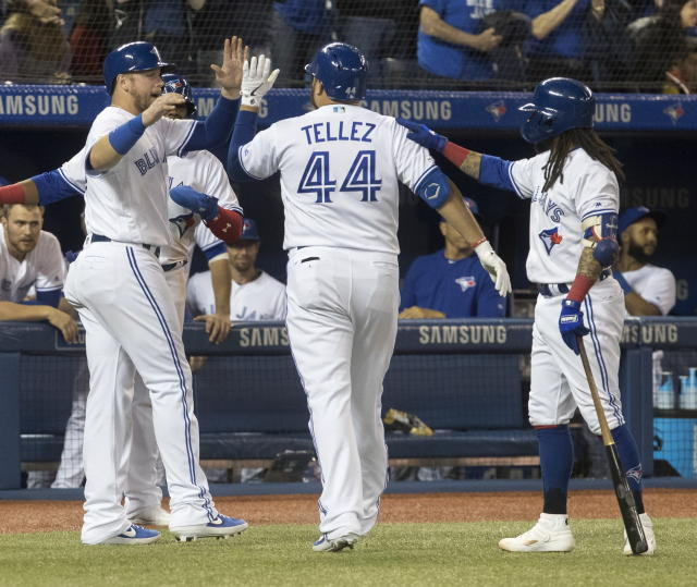 Toronto Blue Jays' Rowdy Tellez is met by teammates after he hit a three-run home run against the Boston Red Sox during the fifth inning of a baseball game Tuesday, May 21, 2019, in Toronto. (Fred Thornhill/The Canadian Press via AP)