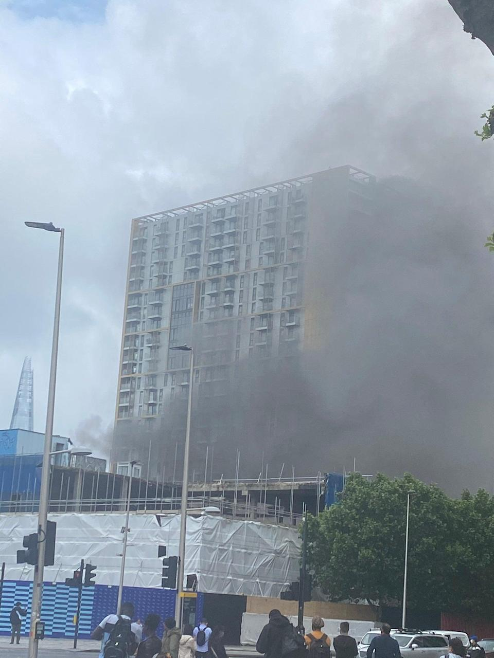 A massive plume of black smoke could be seen rising across the capital's skyline (@adelecarlsen)