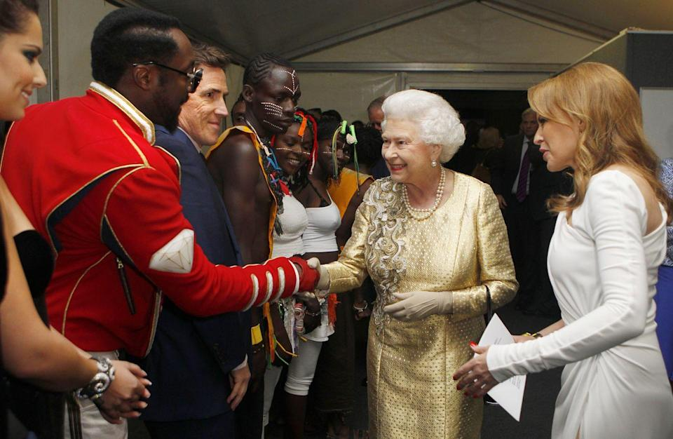 <p>Will.i.am dressed in a red military jacket and pants when he met Queen Elizabeth after his performance at her Diamond Jubilee Concert.</p>
