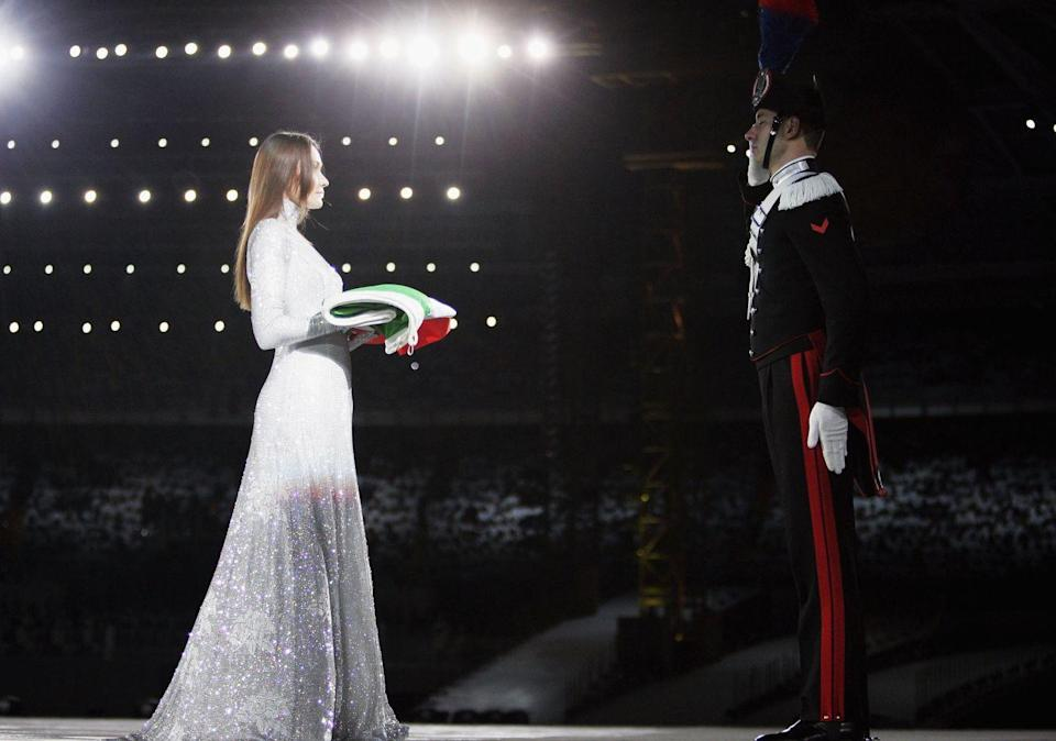 <p>Italian singer and supermodel Carla Bruni performed a song during the opening ceremony in her hometown of Turin. Dressed in a silver sequin ballgown, Bruni then delivered a folded Italian flag to be flown in the stadium. </p>