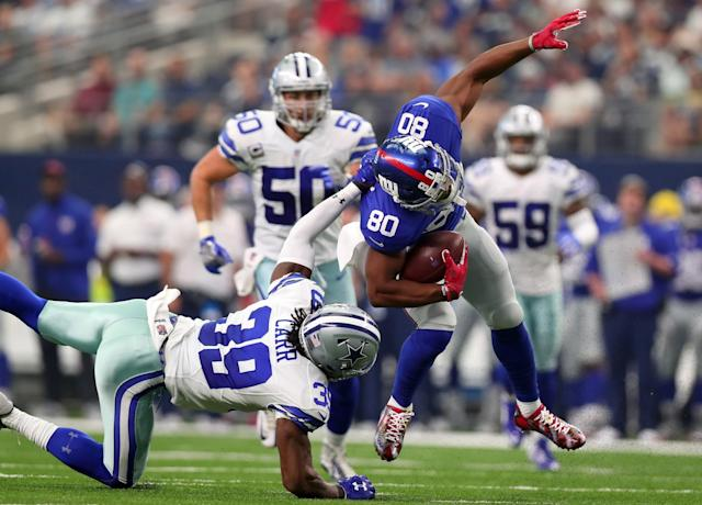 <p>Victor Cruz #80 of the New York Giants is tackled by Brandon Carr #39 of the Dallas Cowboys after catching a pass in the first half at AT&T Stadium on September 11, 2016 in Arlington, Texas. (Photo by Tom Pennington/Getty Images) </p>