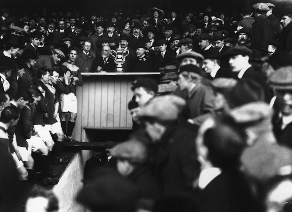 Bradford's players await the FA Cup trophy presentation in 1911 (Getty Images)