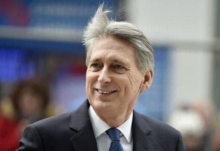 Britain's Chancellor of the Exchequer Philip Hammond  arrives at the National Cyber Security Centre in London
