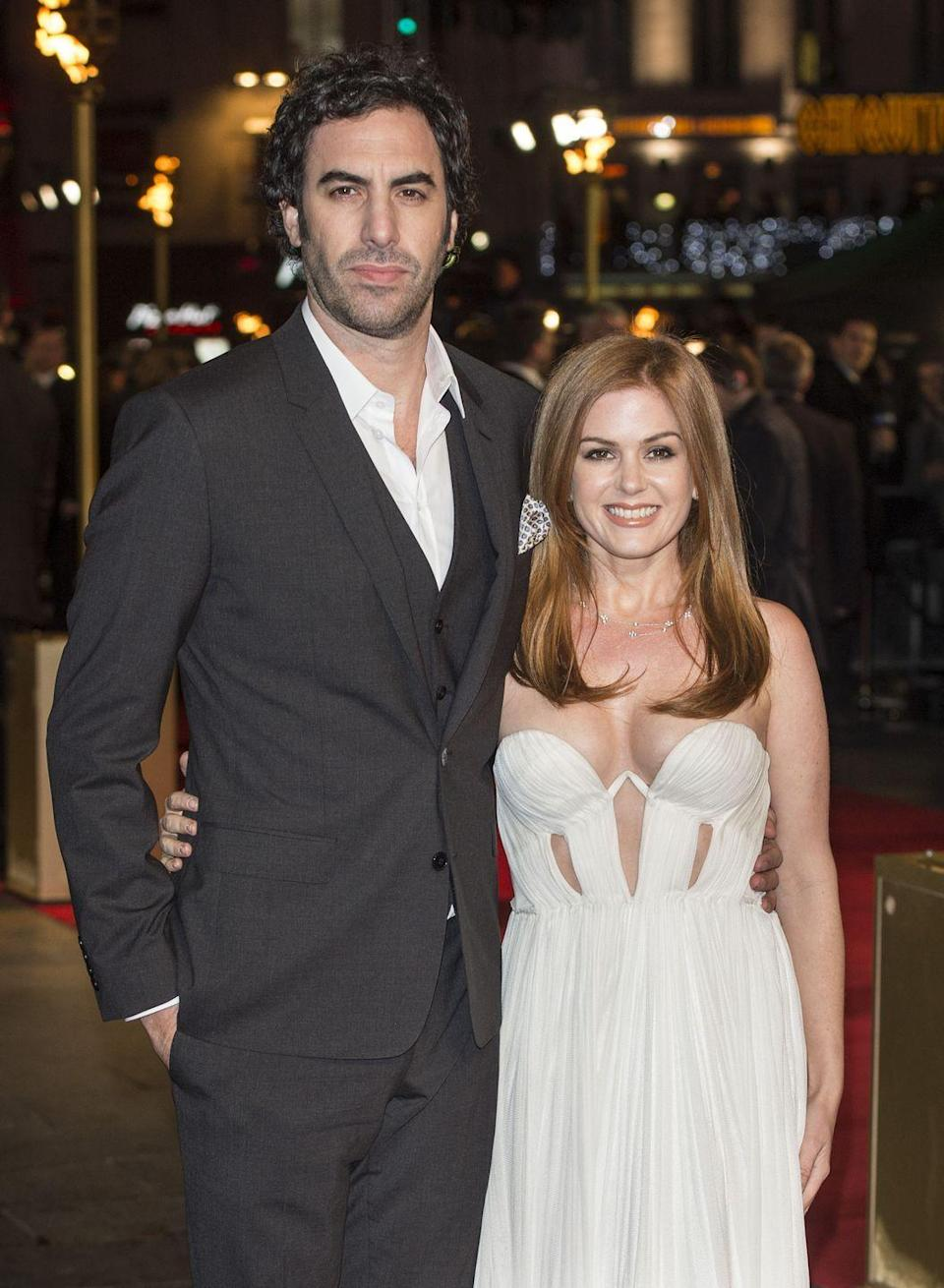 """<p>After meeting in 2002, Isla Fisher and Sacha Baron Cohen got engaged and Isla converted to Judaism for her partner. In 2010, they <a href=""""https://people.com/celebrity/isla-fisher-and-sacha-baron-cohens-secret-six-guest-wedding/"""" rel=""""nofollow noopener"""" target=""""_blank"""" data-ylk=""""slk:informed six guests"""" class=""""link rapid-noclick-resp"""">informed six guests</a> of their elopement plans at the last minute and said """"I do"""" in a small ceremony in Paris. """"It's very important to me to have a beautiful ritual celebrated with my family and friends,"""" Isla told <em><a href=""""https://people.com/celebrity/isla-fisher-and-sacha-baron-cohens-secret-six-guest-wedding/"""" rel=""""nofollow noopener"""" target=""""_blank"""" data-ylk=""""slk:PEOPLE"""" class=""""link rapid-noclick-resp"""">PEOPLE</a></em>. """"And when you are in the public eye, to keep that private and to make it happen without it being really visible is really difficult.""""</p>"""