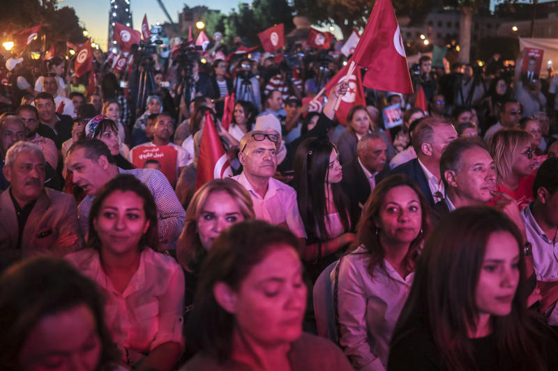 Supporters of Tunisian presidential candidate Nabil Karoui attend a rally on the last day of campaigning before the second round of the presidential elections, in Tunis, Tunisia, Friday, Oct. 11, 2019. (AP Photo/Mosa'ab Elshamy)