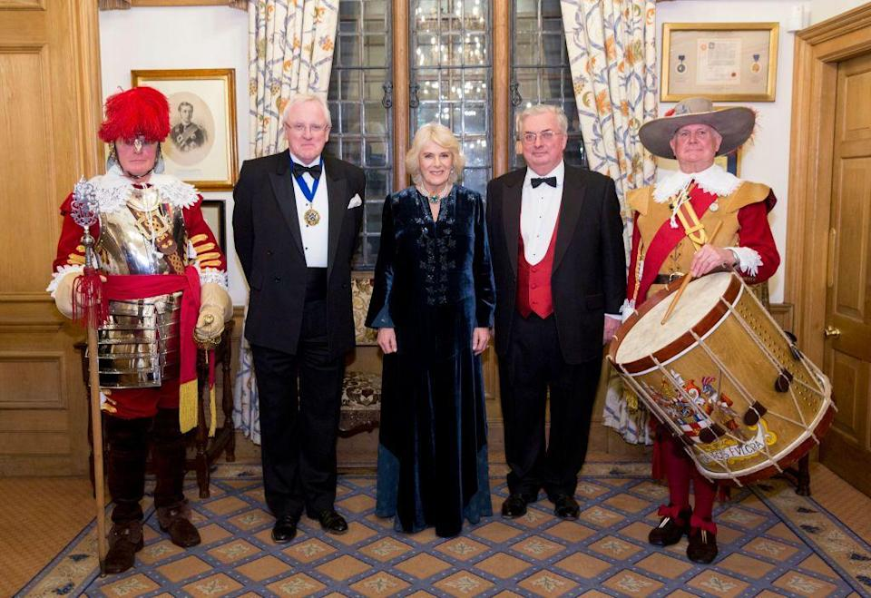 <p>The Duchess of Cornwall wore a dark blue velvet gown with embroidered detailing to a dinner for the English and Welsh wine industry at Vintners Hall. </p>