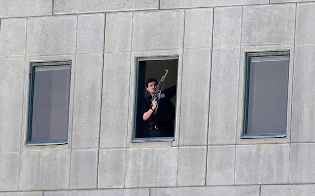 <p>An armed man stands in a window of the parliament building in Tehran, Iran, Wednesday, June 7, 2017. (Photo: Fars News Agency, Omid Vahabzadeh via AP) </p>