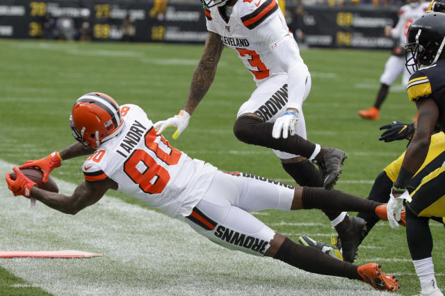 Cleveland Browns wide receiver Jarvis Landry (80) makes a catch in front of Pittsburgh Steelers strong safety Terrell Edmunds (34) in the first half of an NFL football game, Sunday, Dec. 1, 2019, in Pittsburgh. The call was originally called incomplete but was rules a catch on review. (AP Photo/Gene J. Puskar)