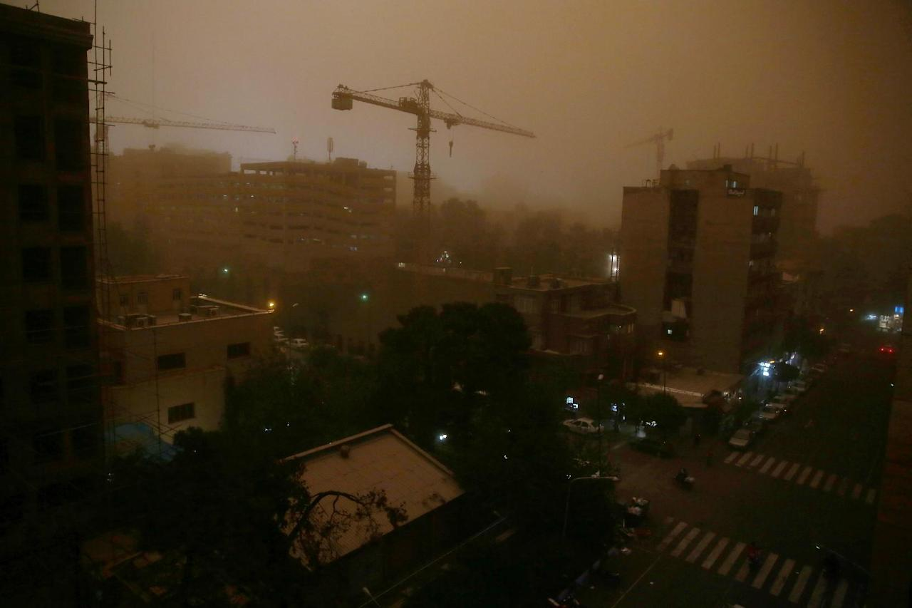 A view of Tehran, Iran, Monday, June 2, 2014, while a flash dust storm hits the Iranian capital. Iran's state TV is reporting that at least two people have been killed and 30 others injured after a heavy dust storm hit the capital Tehran with a speed of 110 kilometers per hour. (AP Photo/Ebrahim Noroozi)