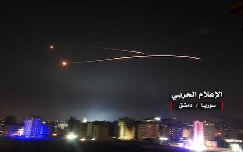Missiles fire is seen over Damascus - Credit: Reuters