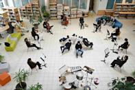 Musicians from the Victor Hugo orchestra play for high school students at the Germaine Tillon high school library in Montbeliard, France