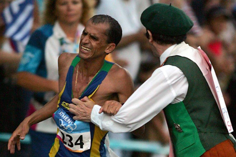 """<p>Brazilian runner Vanderlei de Lima was in the lead at the Olympic marathon in 2004 when <a href=""""https://www.history.com/this-day-in-history/marathoner-assaulted-at-olympics"""" rel=""""nofollow noopener"""" target=""""_blank"""" data-ylk=""""slk:a mentally ill bystander approached him and pushed him into the crowd"""" class=""""link rapid-noclick-resp"""">a mentally ill bystander approached him and pushed him into the crowd</a>. De Lima resumed running, but was overtaken two miles before the finish line to ultimately finish in third. Based on how he handled the incident, de Lima was later awarded the Pierre de Coubertin medal for sportsmanship.</p>"""