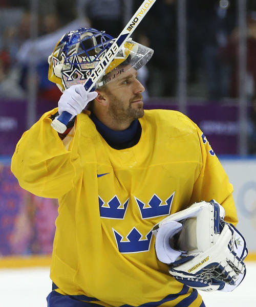Sweden goaltender Henrik Lundqvist waves to hockey fans after shutting out Switzerland 1-0 in a men's ice hockey game at the 2014 Winter Olympics, Friday, Feb. 14, 2014, in Sochi, Russia. (AP Photo/Mark Humphrey)