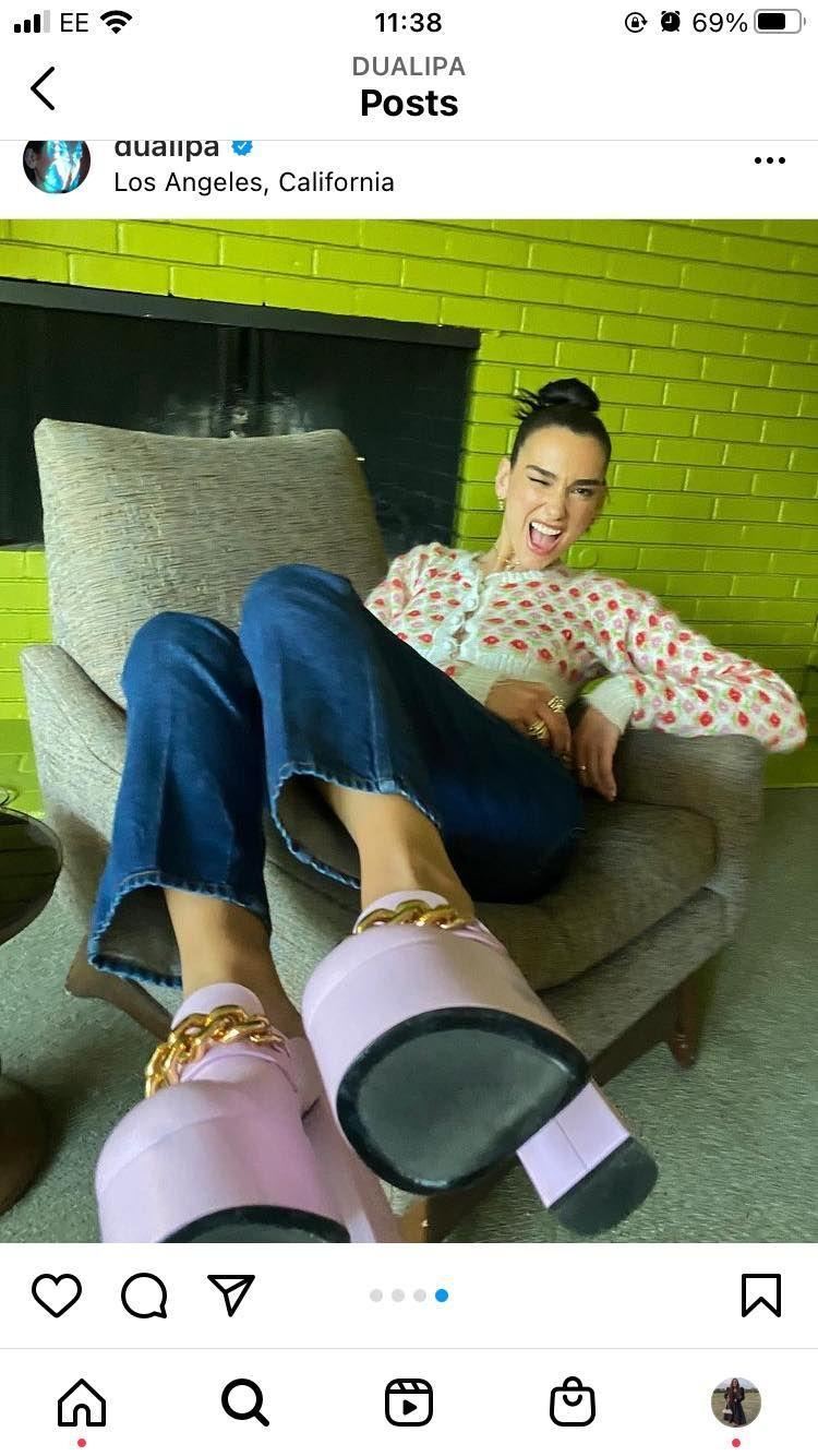 """<p>In a carousel of images shared on her Instagram, Lipa posted pictures of various outfits she's worn while out promoting.</p><p>In this shot, Lipa looked playful in an Ashley Williams cardigan, Levi's jeans and Versace platforms. </p><p><a class=""""link rapid-noclick-resp"""" href=""""https://go.redirectingat.com?id=127X1599956&url=https%3A%2F%2Fwww.net-a-porter.com%2Fen-gb%2Fshop%2Fsearch%2Fversace&sref=https%3A%2F%2Fwww.elle.com%2Fuk%2Ffashion%2Fcelebrity-style%2Fg19613955%2Fdua-lipas-style-file%2F"""" rel=""""nofollow noopener"""" target=""""_blank"""" data-ylk=""""slk:SHOP VERSACE NOW"""">SHOP VERSACE NOW</a></p>"""